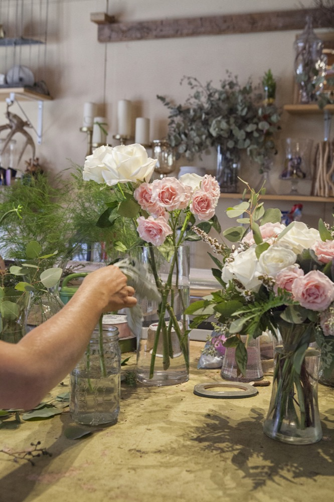 A florist working in Petals & Oak Toronto floral studio.